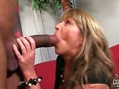 Awesome mature blonde hungrily tastes massive black dong.